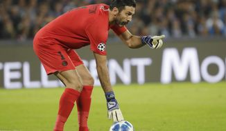 PSG goalkeeper Gianluigi Buffon gestures during a Champions League, group C soccer match between Napoli and Paris Saint Germain, at the San Paolo stadium in Naples, Italy, Tuesday, Nov. 6, 2018. (AP Photo/Andrew Medichini)