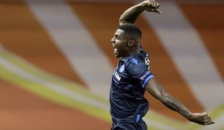Brugge forward Wesley Moraes celebrates his goal during the Champions League Group A soccer match between Monaco and Club Brugge at the Louis II stadium in Monaco, Tuesday, Nov. 6, 2018. (AP Photo/Claude Paris)