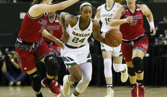 Baylor guard Chloe Jackson (24) drives past Nicholls State guard Cassidy Barrios, left, in the first half of an NCAA college basketball game on Tuesday, Nov. 6, 2018, in Waco, Texas. (AP Photo/Ray Carlin)