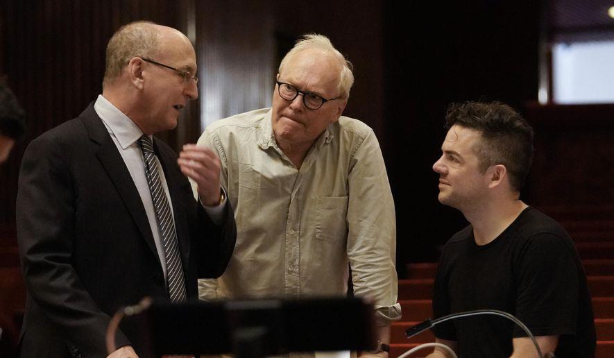 """This Oct. 11, 2018 photo released by the Metropolitan Opera shows Composer Nico Muhly, right, with general manager Peter Gelb, left, and librettist Nicholas Wright during rehearsals for """"Marnie,"""" at the Metropolitan Opera in New York. (Ken Howard/Metropolitan Opera via AP)"""