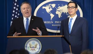 Secretary of State Mike Pompeo, left, and Treasury Secretary Steven Mnuchin, present details of the new sanctions on Iran, at the Foreign Press Center in Washington, Monday, Nov. 5, 2018. (AP Photo/J. Scott Applewhite)