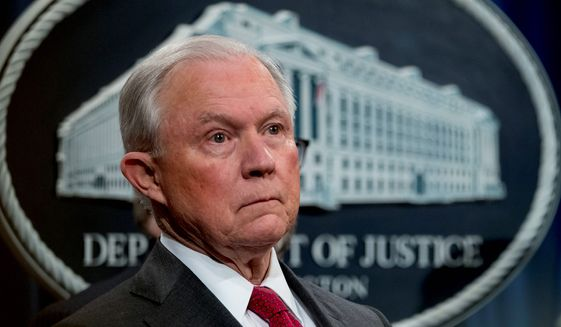 Then-Attorney General Jeff Sessions listens to reporters at a news conference in mid-October at the Justice Department in Washington. (Associated Press)