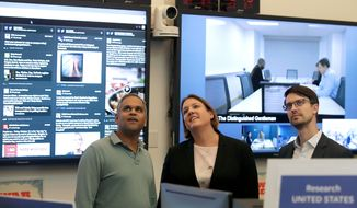 Nathaniel Gleicher (right), Facebook's head of cybersecurity policy, monitors election-related content on the social media platform with Samidh Chakrabarti (left), director of elections and civic engagement, and Katie Harbath, global politics and government outreach director. (Associated Press)