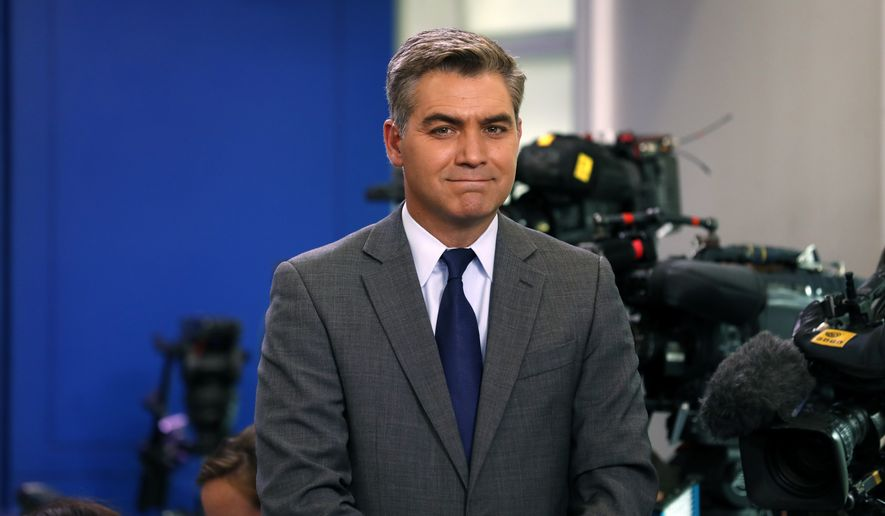CNN's senior White House correspondent Jim Acosta waits to do a stand up before an off-camera press briefing at the White House, Tuesday, July 11, 2017, in Washington. (AP Photo/Alex Brandon)