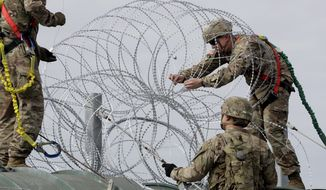 Military members have placed razor wire along the U.S.-Mexico border, but the Pentagon says it has legal authority to build border fencing if it is deemed part of a counterdrug operation or part of a national emergency. (Associated Press/File)