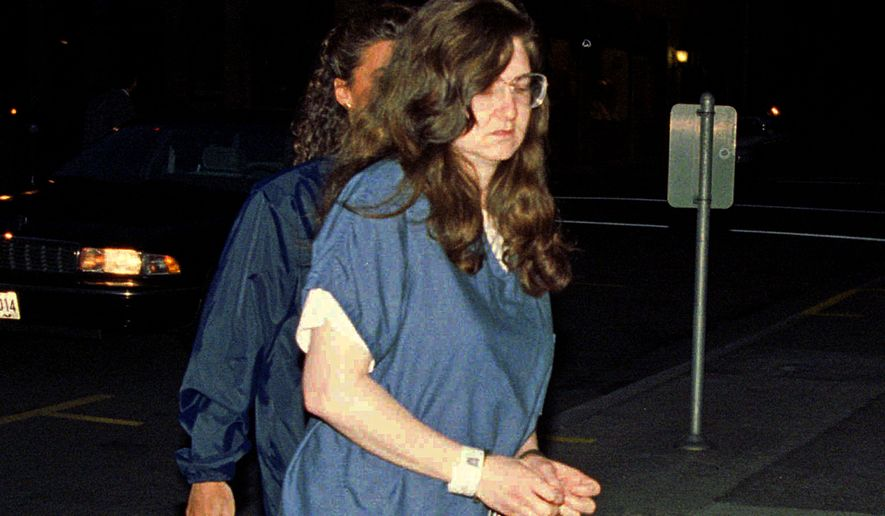 "In this Sept. 8, 1995 file photo, Rachelle ""Shelley"" Shannon arrives for sentencing in federal court in downtown Portland, Ore. Shannon, an anti-abortion activist who shot Wichita, Kan., abortion doctor George Tiller in 1993 and committed clinic attacks in several states, has been released from imprisonment in Oregon. The U.S. Bureau of Prisons confirmed Wednesday, Nov. 7, 2018, that Shannon has been released. The Kansas City Star reports Shannon was staying at a halfway house in Portland since May. She has been in custody for 25 years. (Ben Brink /The Oregonian via AP, File)"