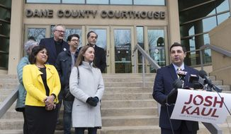 Democratic candidate for state attorney general Josh Kaul, right, claims victory during a news conference Wednesday, Nov. 7, 2018 at the Dane County Courthouse in Madison, Wis. (Mark Hoffman/Milwaukee Journal-Sentinel via AP)