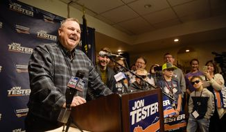 Sen. Jon Tester surrounded by family and supporters, announces his victory Wednesday, Nov. 7, 2018 in Great Falls, Mont.  Tester has won a third term in the U.S. Senate by beating Republican Matt Rosendale. Tester won Tuesday's close election despite President Donald Trump taking a personal interest in defeating him.  (Thom Bridge /Independent Record via AP)