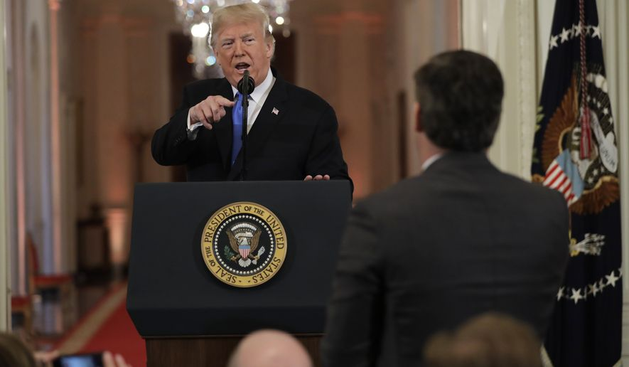 President Donald Trump speaks with CNN White House correspondent Jim Acosta during a news conference in the East Room of the White House, Wednesday, Nov. 7, 2018, in Washington. (AP Photo/Evan Vucci)