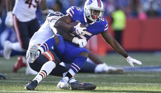 FILE - In this Sunday, Nov. 4, 2018, file photo, Buffalo Bills running back LeSean McCoy (25) is tackled during the second half of an NFL football game against the Chicago Bears in Orchard Park, N.Y. McCoy has been as invisible on the field as he has been off it in refusing to speak to the media for the past 10 days. It's a sign of his frustrations, as McCoy has yet to score this season and combined for 23 yards rushing on 22 carries in his past two games. (AP Photo/Adrian Kraus, File)