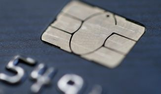 FILE- This June 10, 2015, file photo shows a chip credit card in Philadelphia. On Wednesday, Nov. 7, 2018, the Federal Reserve releases its September report on consumer borrowing. (AP Photo/Matt Rourke, File)