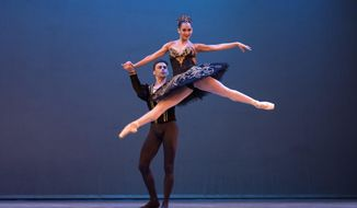 In this Oct. 29, 2018 photo, Cuban expatriate ballet dancers Taras Domitro and Adianys Almeida, top, perform in Havana, Cuba. Cuba has invited a record number of expatriate dancers to its international dance festival. (AP Photo/Desmond Boylan)
