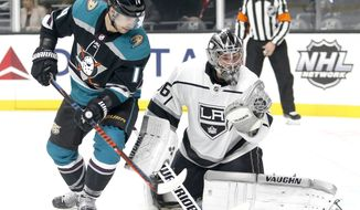 Los Angeles Kings goalie Jack Campbell (36) makes a save next to Anaheim Ducks forward Adam Henrique (14) during the first period of an NHL hockey game Tuesday, Nov. 6, 2018, in Los Angeles. (AP Photo/Ringo H.W. Chiu)