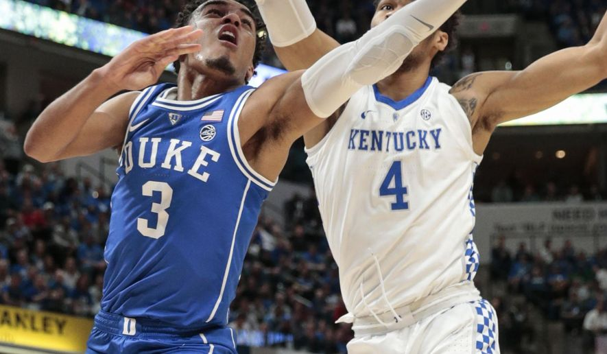 Duke guard Tre Jones (3) next to Kentucky forward Nick Richards (4) during the first half of an NCAA college basketball game at the Champions Classic in Indianapolis on Tuesday, Nov. 6, 2018. (AP Photo/AJ Mast)