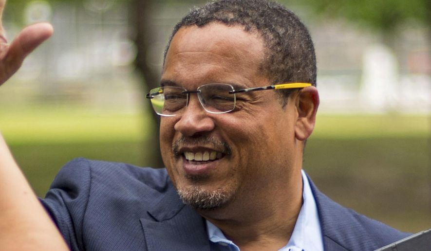 In this Aug. 17, 2017, file photo, Minnesota Democratic U.S. Rep. Keith Ellison high-fives one of his campaign volunteers in Minneapolis. (Alex Kormann/Star Tribune via AP, File)