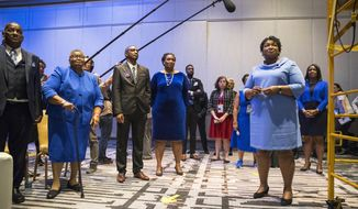 Georgia gubernatorial candidate Stacey Abrams, right, waits backstage with her family and friends before speaking to a crowd of supporters during her election night watch party at the Hyatt Regency in Atlanta, Wednesday, Nov. 7, 2018. Georgia's hotly contested and potentially historic governor's race may not be over yet, with Democrat Abrams and Republican Brian Kemp awaiting the final accounting of absentee and provisional ballots. (Alyssa Pointer/Atlanta Journal-Constitution via AP)