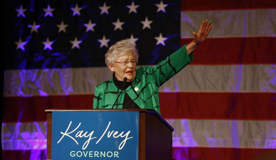 Alabama Gov. Kay Ivey waves as she speaks to supporters at a watch party after she won the gubernatorial election, Tuesday, Nov. 6, 2018, in Montgomery, Ala. Ivey, who became Alabama's governor last year when her predecessor resigned in a cloud of scandal, was elected Tuesday to a full term after fending off a challenge from Democratic rival Walt Maddox. (AP Photo/Butch Dill)