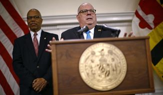 Maryland Gov. Larry Hogan, right, speaks at a news conference alongside Lt. Gov. Boyd Rutherford, Wednesday, Nov. 7, 2018, at the Maryland State House in Annapolis, Md. Hogan earned a second term Tuesday after defeating Democratic opponent Ben Jealous. (AP Photo/Patrick Semansky)