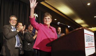 Democrat Laura Kelly waved to the crowd at the Ramada Hotel and Convention Center in Topeka after she won election Tuesday, Nov. 6, 2018, to become the next Kansas governor. (Thad Allton /The Topeka Capital-Journal via AP)