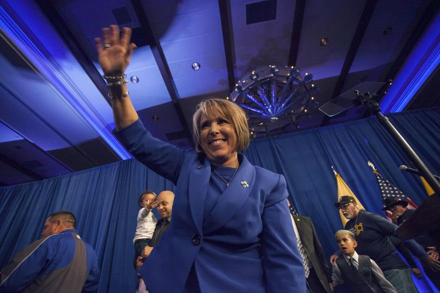 New Mexico Gov.-elect Michelle Lujan-Grisham waves to supporters following her acceptance speech in Albuquerque, N.M. Tuesday, Nov. 6, 2018. (AP Photo/Juan Labreche)