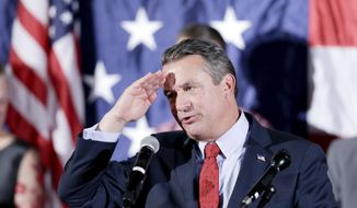 Rep. Don Bacon, R-Neb., salutes as he addresses supporters in Omaha, Neb., Tuesday, Nov. 6, 2018. (AP Photo/Nati Harnik) ** FILE **