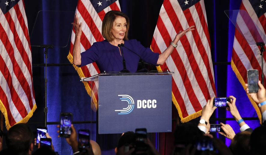 House Minority Leader Nancy Pelosi of Calif., smiles as she is cheered by a crowd of Democratic supporters during an election night returns event at the Hyatt Regency Hotel, on Tuesday, Nov. 6, 2018, in Washington. (AP Photo/Jacquelyn Martin)