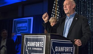 U.S. Rep. Greg Gianforte speaks as the results come in at the Hilton Garden Inn Tuesday, Nov. 6, 2018, in Bozeman, Mont. Gianforte has a lead over Democratic challenger Kathleen Williams, but Montana's U.S. House race is too close to call with votes left to be counted. (Rachel Leathe/Bozeman Daily Chronicle via AP)