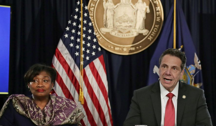 FILE - In this April 4, 2018 file photo, New York Gov. Andrew Cuomo speaks during a news conference in New York with Sen. Andrea Stewart-Cousins, D-Yonkers, left, who could become the first woman and first African-American to lead the 63-member Senate in January. In Tuesday's election Democrats seized power in the Senate from Republicans, who have long used their power in the chamber to block Democratic priorities.(AP Photo/Frank Franklin II, File)
