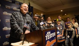 Sen. Jon Tester surrounded by family and supporters, announces his victory Wednesday, Nov. 7, 2018 in Great Falls, Mont.  Tester has won a third term in the U.S. Senate by beating Republican Matt Rosendale.Tester won Tuesday's close election despite President Donald Trump taking a personal interest in defeating him.  (Thom Bridge /Independent Record via AP)