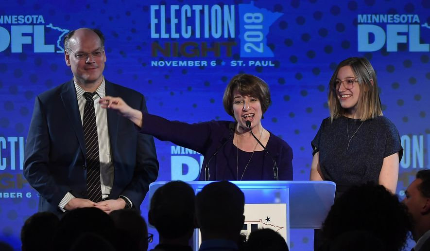 Democratic U.S. Sen. Amy Klobuchar stands beside her husband, John Bessler, and her daughter, Abigail, during her victory speech at the DFL headquarters election party at the Intercontinental Hotel Tuesday, Nov. 6, 2018, in St. Paul, Minn. Klobuchar defeated Republican state Rep. Jim Newberger. (Aaron Lavinsky/Star Tribune via AP) ** FILE **
