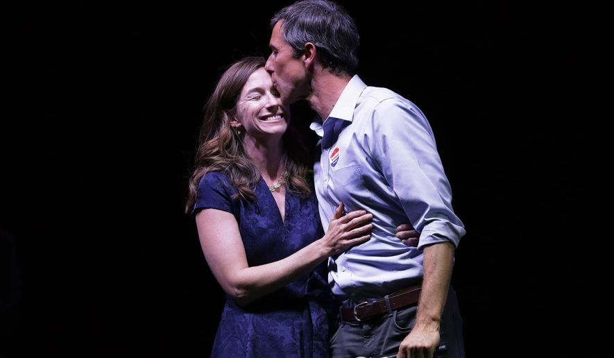 Rep. Beto O'Rourke, D-Texas, the 2018 Democratic Candidate for U.S. Senate in Texas, right, stands with his wife, Amy Sanders, at his election night party, Tuesday, Nov. 6, 2018, in El Paso, Texas.  (AP Photo/Eric Gay)