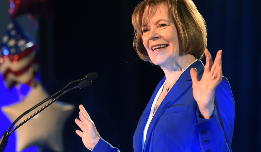 Sen. Tina Smith, D-Minn., speaks after winning a special election race to fill the vacated seat of former Sen. Al Franken during a election night event Tuesday, Nov. 6, 2018, in St. Paul, Minn. (AP Photo/Hannah Foslien)