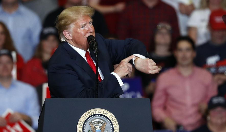 President Donald Trump looks at his watch near the end of a campaign rally Monday, Nov. 5, 2018, in Cape Girardeau, Mo. (AP Photo/Jeff Roberson)