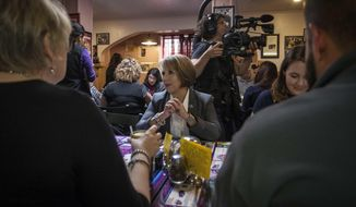 New Mexico Democratic gubernatorial candidate Michelle Lujan Grisham sits down to eat at Barelas Coffee House restaurant in Albuquerque, N.M., on midterms election day Tuesday, Nov. 6, 2018. (AP Photo/Juan Labreche)