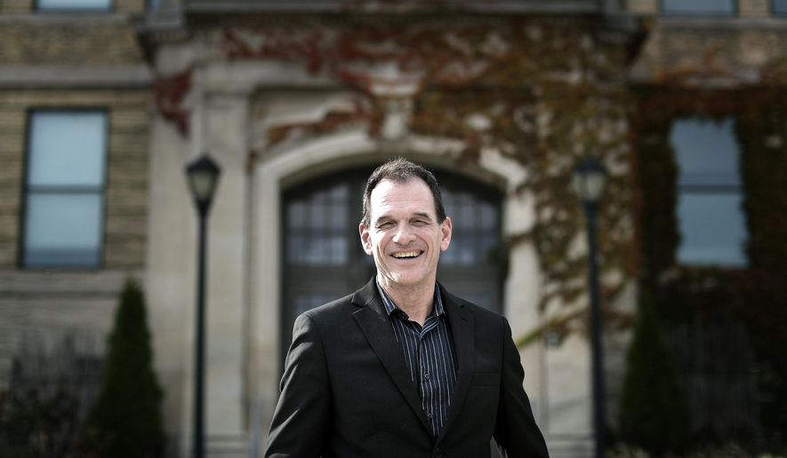 In this Oct. 4, 2018 photo, Brent Bilodeau poses in Janesville, Wis. Bilodeau will receive the Dr. P.B. Poorman Award on Thursday, Nov. 8, for his work to make the UW-Whitewater campus a welcoming place for LGBTQ students. (Anthony Wahl/The Janesville Gazette via AP)