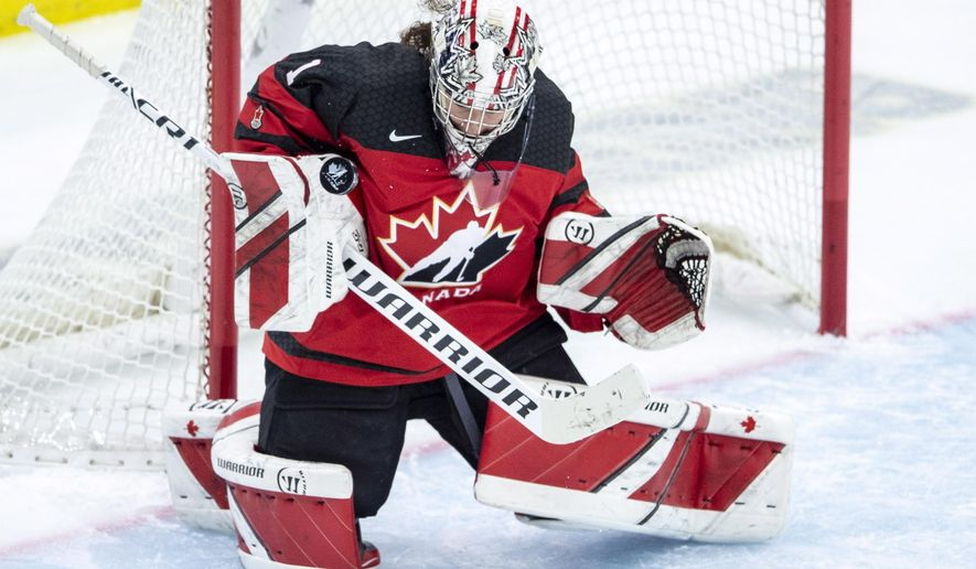 Canada goaltender Shannon Szabados stops a U.S. shot during the first period of a Four Nations Cup hockey preliminary game in Saskatoon, Saskatchewan, Wednesday, Nov. 7, 2018. (Liam Richards/The Canadian Press via AP)