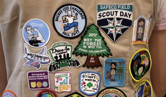 "In this  June 18, 2018, file photo, patches cover the back of a Girl Scout's vest at a demonstration of some of their activities in Seattle. The Girl Scouts of the United States of America filed a trademark infringement lawsuit on Monday, Nov. 5, against the Boy Scouts of America for dropping the word ""boy"" from its flagship program in an effort to attract girls. (AP Photo/Elaine Thompson) **FILE**"
