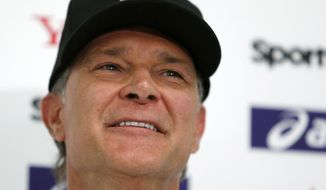 MLB All-Star manager Don Mattingly speaks during a press conference at Tokyo Dome in Tokyo Wednesday, Nov. 7, 2018. Mattingly is in Japan as part of a Major League Baseball All-Star tour that features six games against Japan's national team. (AP Photo/Toru Takahashi)