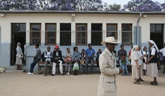 Voters queue to cast their votes at a polling station in Antananarivo, Madagascar, Wednesday, Nov. 7, 2018. Voters go to the polls to elect a president with hopes that a new leader will take the Indian Island nation out of chronic poverty and corruption. (AP Photo/Kabir Dhanji)