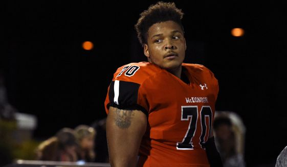 In this Sept. 16, 2016, photo, McDonogh high school football lineman Jordan McNair watches from the sideline during a game in McDonogh, Md. Maryland has fired two trainers that were involved in the treatment of Jordan McNair after he collapsed on the field and subsequently died of heatstroke. Maryland has not formally announced the decision and has never named the trainers, but The Associated Press reported in August Wes Robinson and Steve Nordwall had been placed on leave. (Barbara Haddock Taylor/The Baltimore Sun via AP) **FILE**