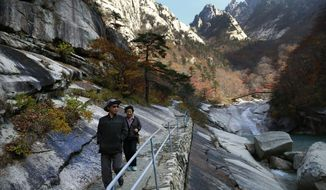 """In this Oct. 23, 2018, photo, local tourists walk on the trail at Mount Kumgang, North Korea. At the height of South Korea's policy of engagement with the North, the """"Diamond Mountain Resort"""" area was a symbol of cooperation. More than 2 million South Korean tourists came to visit and some of the South's biggest corporations poured more than a billion dollars into what they hoped would be a world-class travel destination. Today it's almost deserted after Seoul suspended all travel to Kumgang following the fatal shooting of a South Korean tourist in 2008. (AP Photo/Dita Alangkara)"""