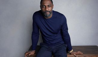 "FILE - In this Jan. 21, 2018, file photo, actor-director Idris Elba poses for a portrait to promote his film ""Yardie"" at the Music Lodge during the Sundance Film Festival in Park City, Utah. On Monday, Nov. 5, 2018, Elba was named Sexiest Man Alive by People magazine. (Photo by Taylor Jewell/Invision/AP, File)"