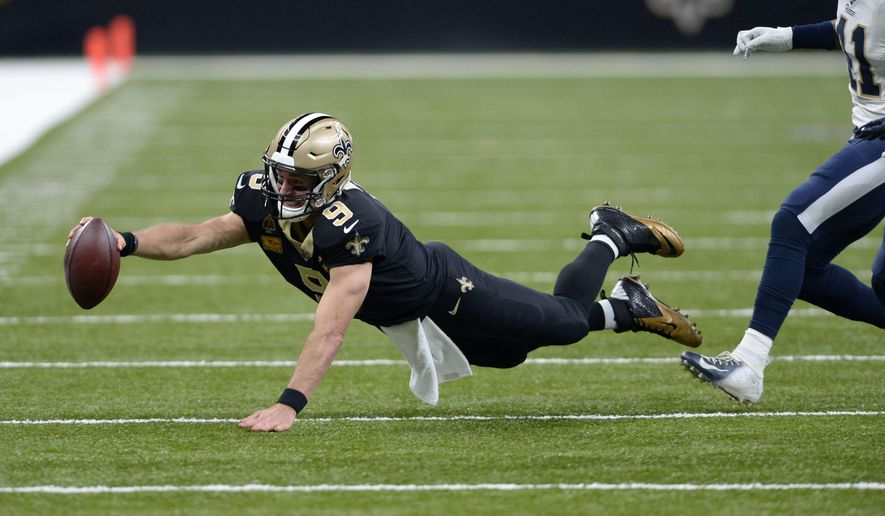 New Orleans Saints quarterback Drew Brees (9) dives as he scrambles for yardage in the first half of an NFL football game against the Los Angeles Rams in New Orleans, Sunday, Nov. 4, 2018. (AP Photo/Bill Feig)