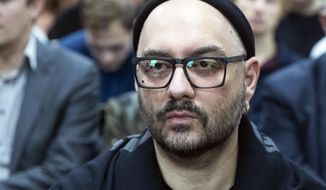 Russian theatre and film director Kirill Serebrennikov waits for a start of court hearing in Moscow, Russia, Wednesday, Nov. 7, 2018. Serebrennikov has been under house arrest since August 2017 on charges of embezzling 133 million rubles (1bout $2 million) of state funding for a theater project, accusations he denies. (AP Photo/Pavel Golovkin)