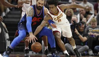 Cleveland Cavaliers' Collin Sexton (2) and Oklahoma City Thunder's Steven Adams (12),  of New Zealand, reach for the ball during the first half of an NBA basketball game Wednesday, Nov. 7, 2018, in Cleveland. (AP Photo/Tony Dejak)