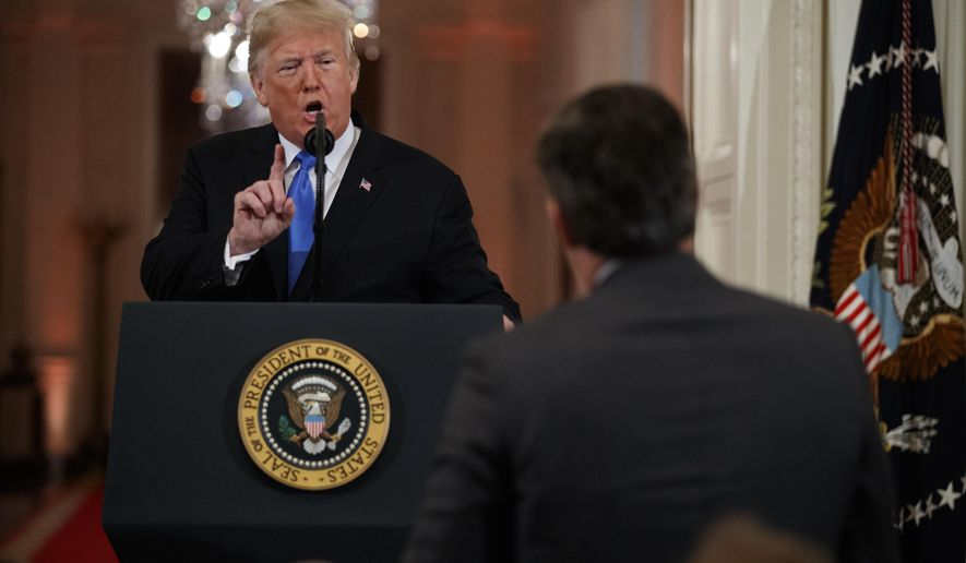 President Donald Trump speaks to CNN journalist Jim Acosta during a news conference in the East Room of the White House, Wednesday, Nov. 7, 2018, in Washington. (AP Photo/Evan Vucci)