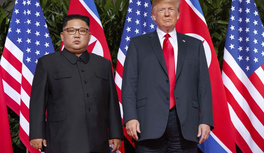 In this June 12, 2018, file photo, U.S. President Donald Trump, right, stands with North Korean leader Kim Jong Un on Sentosa Island in Singapore. North Korea and the United States are trying to revive stalled diplomacy meant to rid the North of its nuclear weapons. There was much talk of the possibility of success following a meeting in June between Trump and Kim, but in the months since there has been little to quiet skeptics who believe the North will never give up weapons it has described as necessary to counter a hostile Washington. (AP Photo/Evan Vucci) **FILE**