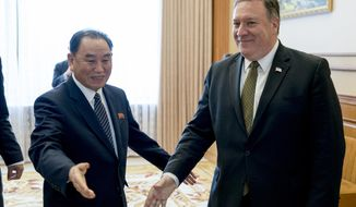 In this July 7, 2018, photo, U.S. Secretary of State Mike Pompeo, right, and Kim Yong Chol, a North Korean senior ruling party official and former intelligence chief, arrive for a lunch at the Park Hwa Guest House in Pyongyang, North Korea. Kim Yong Chol, a senior North Korean envoy's meeting with U.S. Secretary of State Pompeo has been delayed, throwing already deadlocked diplomacy over the North's nuclear weapons into further uncertainty. (AP Photo/Andrew Harnik, Pool) **FILE**