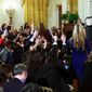 The White House press corps vies for a chance to question President Trump on Wednesday prior to a sparring match between Mr. Trump and CNN reporter Jim Acosta. The incident received national attention. (Associated Press)