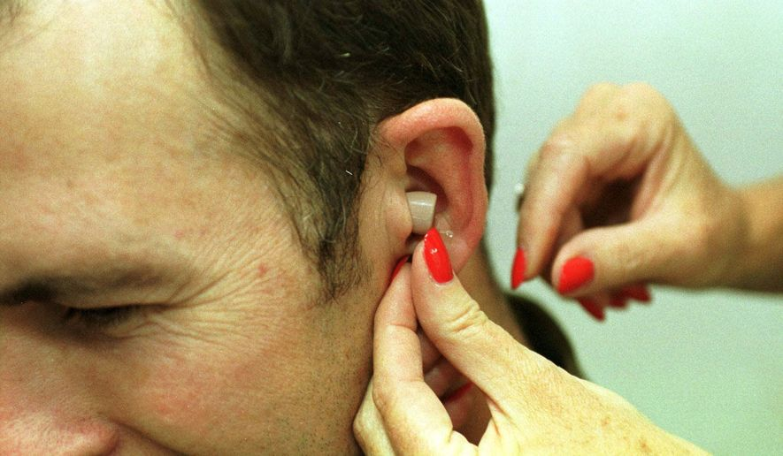 David Trent has a Songbird disposable hearing aid put in his ear on Thursday, July 27, 2000 at an audiological clinic in Atlanta.  Songbird, manufactured by Songbird Hearing Inc. of Cranbury, N.J., is disposable because the batteries don't need to be replaced. When the hearing aid wears out in 30 to 40 days, it can be thrown away. (AP Photo/Alan Mothner)